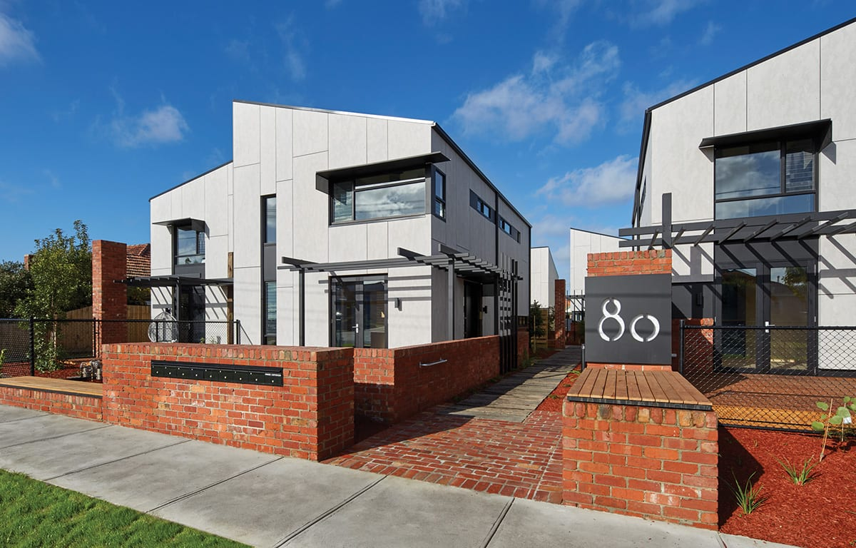 Outside view of grey and red brick townhouses in Thornbury