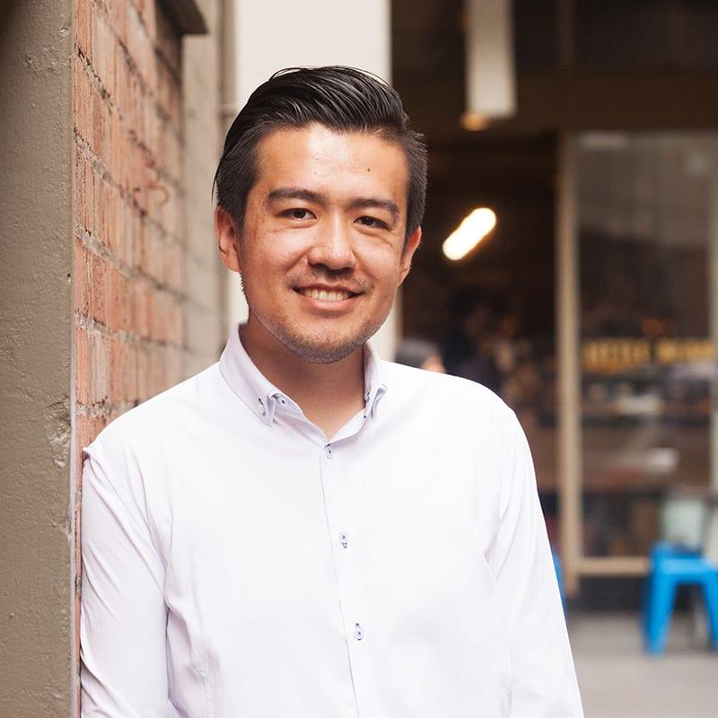 Rui Liu standing in city laneway