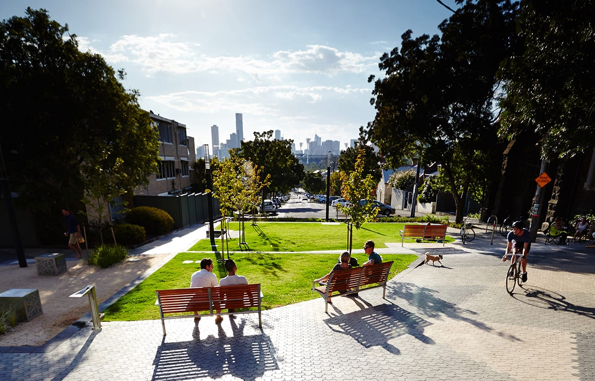 People sitting on park benches at Richmond Terrace