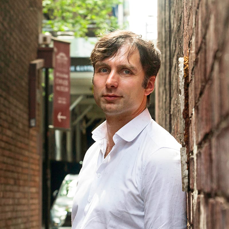 Dave Witty standing in a city laneway