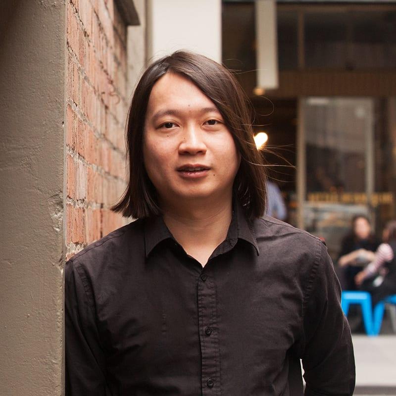 Sang Han Tat standing in city laneway